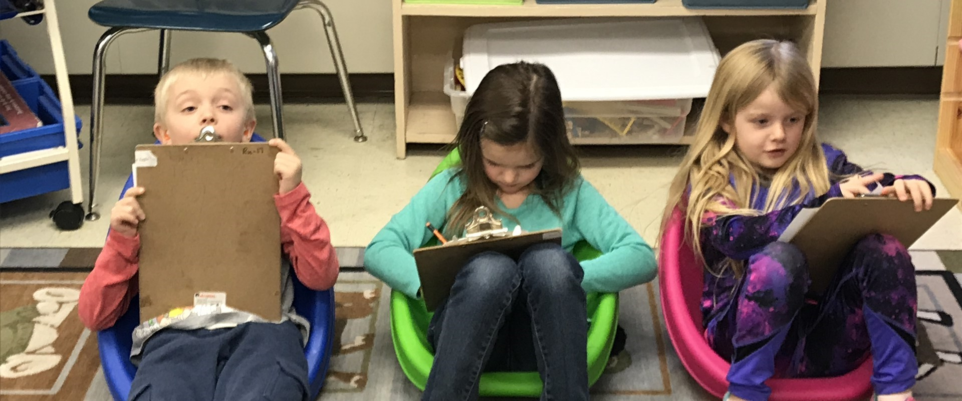 Mrs. Jans's students writing and enjoying new alternative seating.
