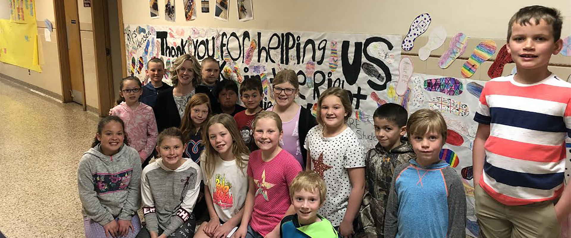 "?Mrs. Hansen with giant ""Thank You"" poster from BRE students.?"